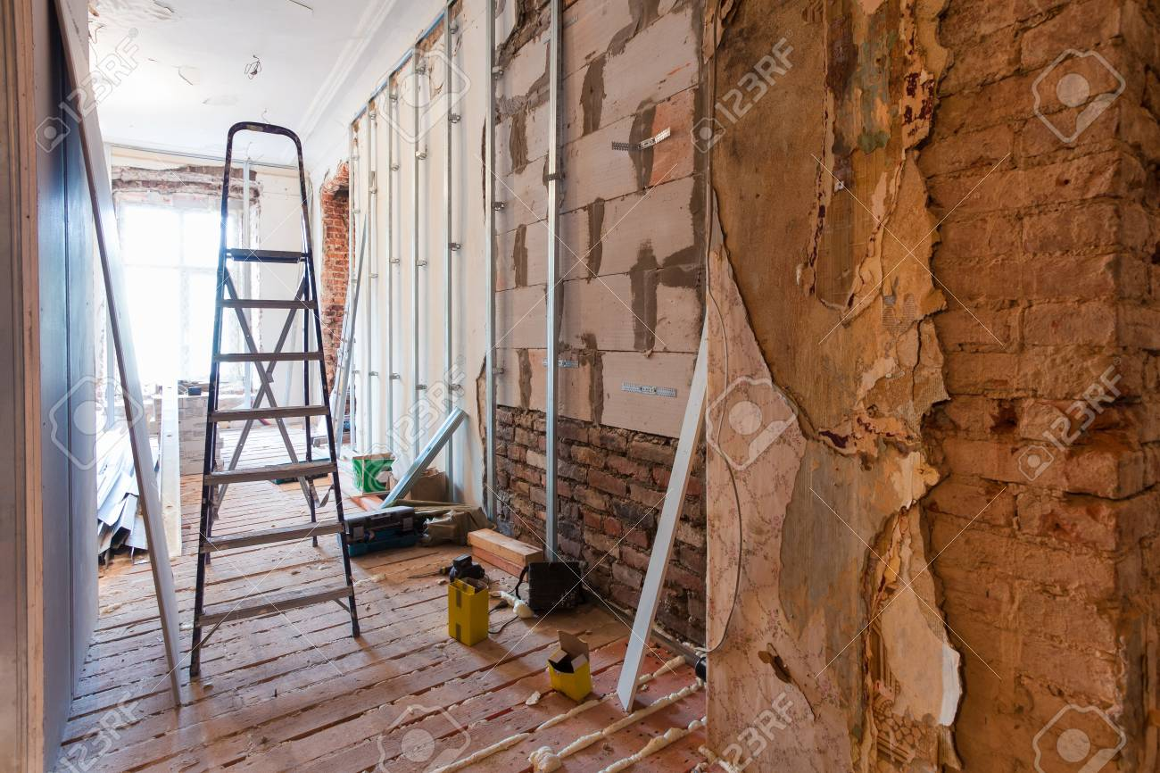 Interior of apartment with materials during on the renovation and construction ( making wall from gypsum plasterboard) - 73401611