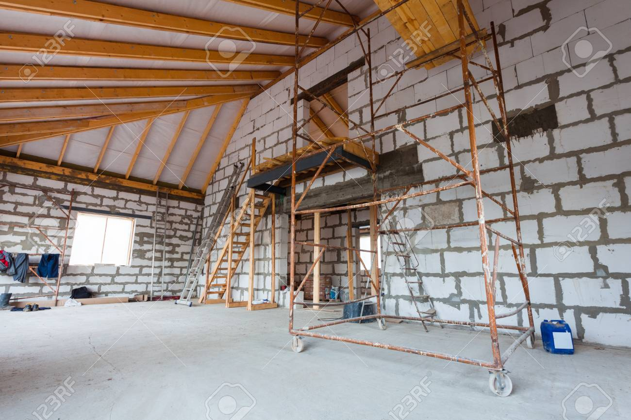 Ladder, parts of scaffolding and construction material on the floor during on the remodeling, renovation, extension, restoration, reconstruction and construction - 92366771