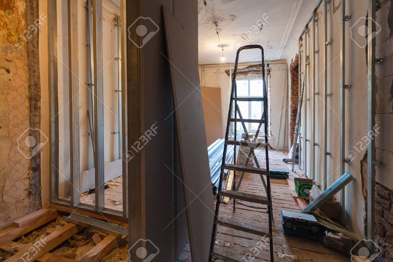 Interior of upgrade apartment with materials during on the remodeling, renovation, extension, restoration, reconstruction and construction. ( making wall from gypsum plasterboard) - 89720969