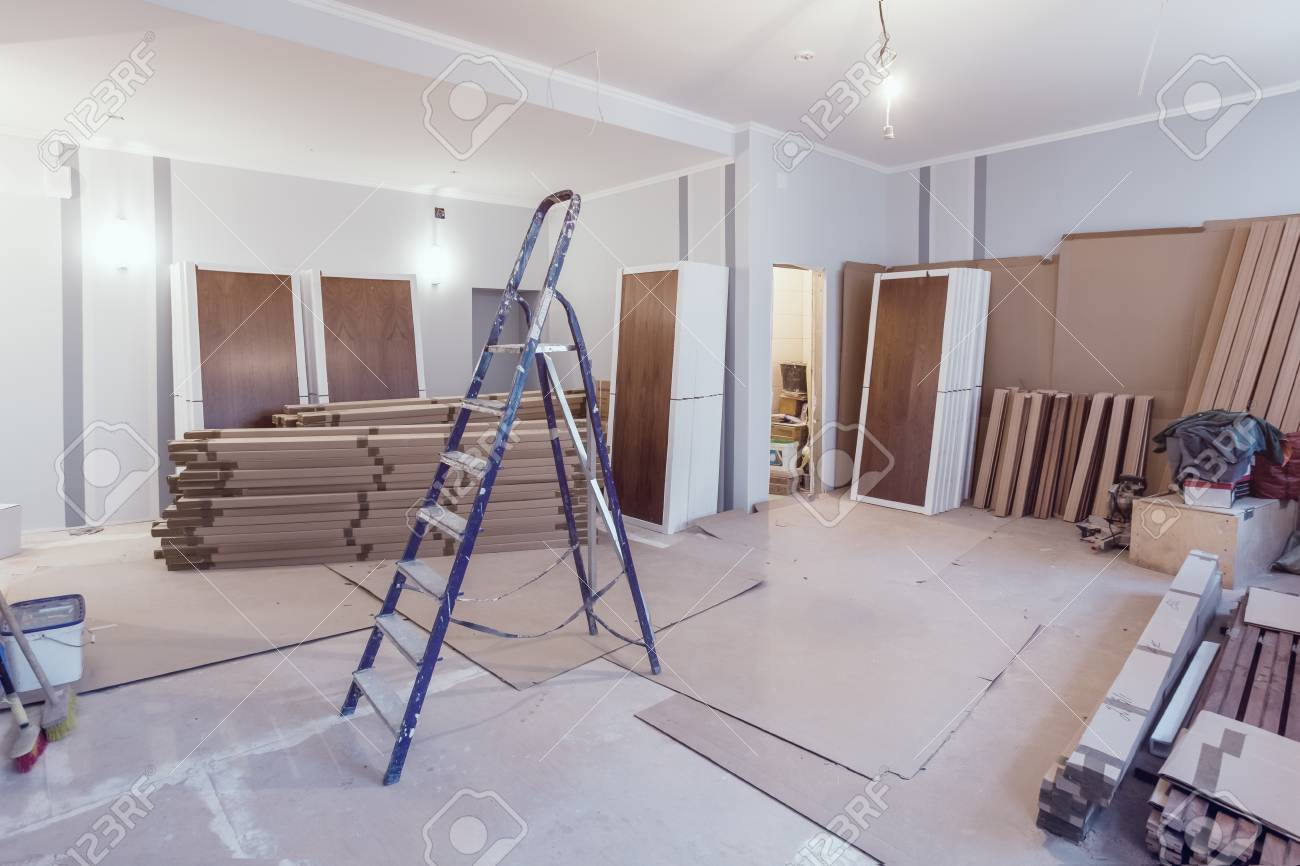 Interior of apartment during construction, remodeling, renovation, extension, restoration and reconstruction - ladder and construction materials in the room - 97606872