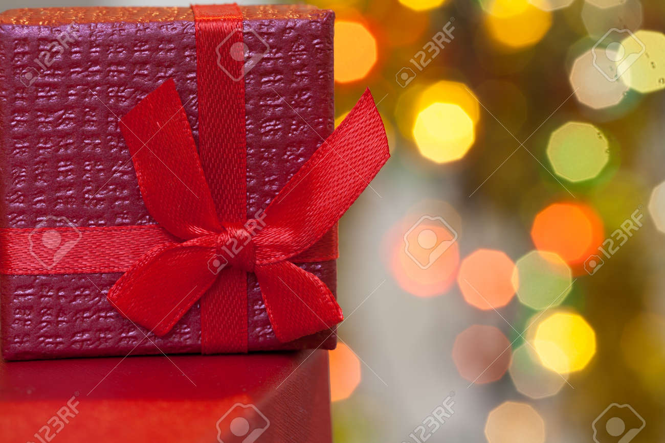 Boxes with christmas gifts with red bow and christmas bokeh light abstract holiday background - 168607749