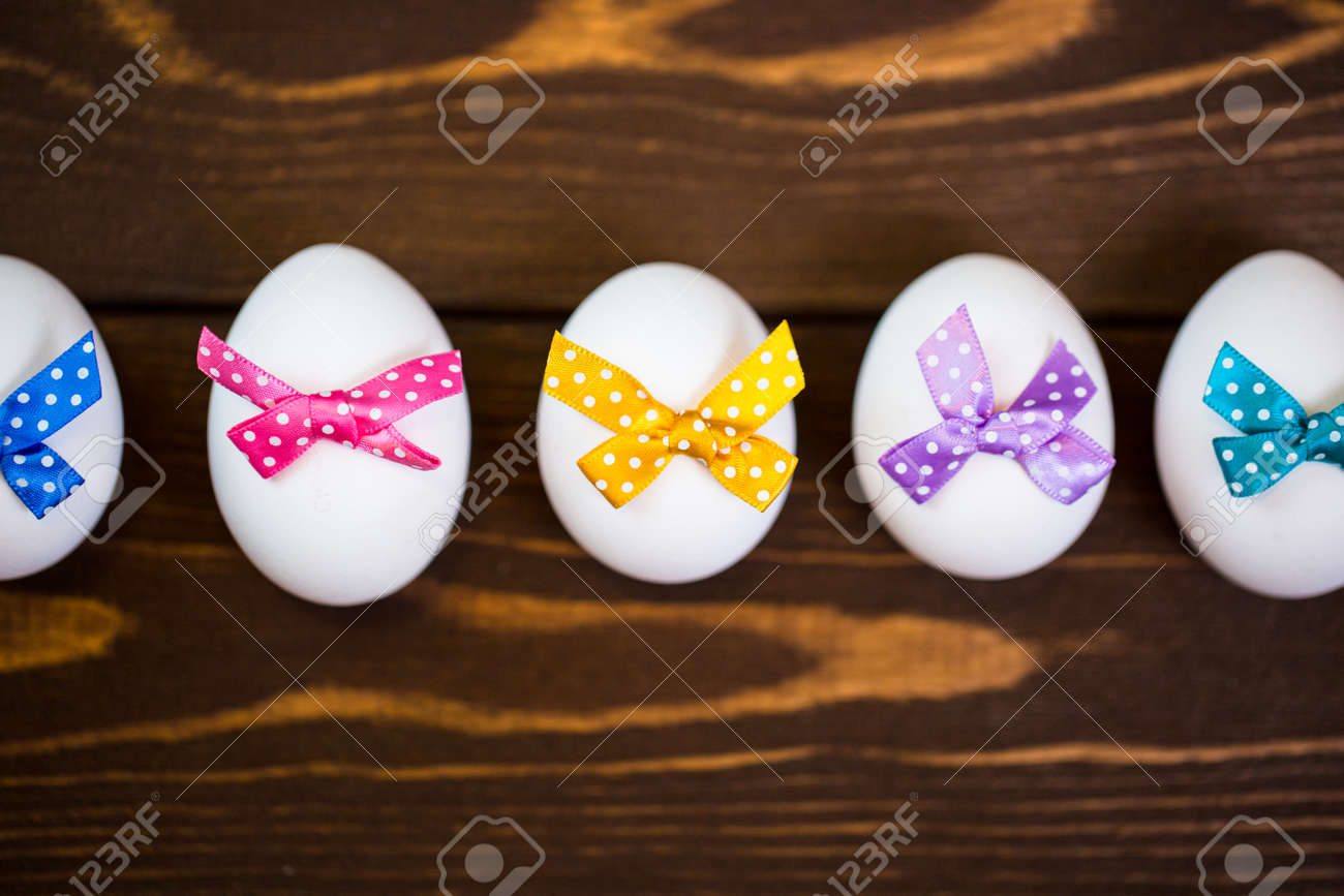 Easter eggs with colorful bow - 168607754