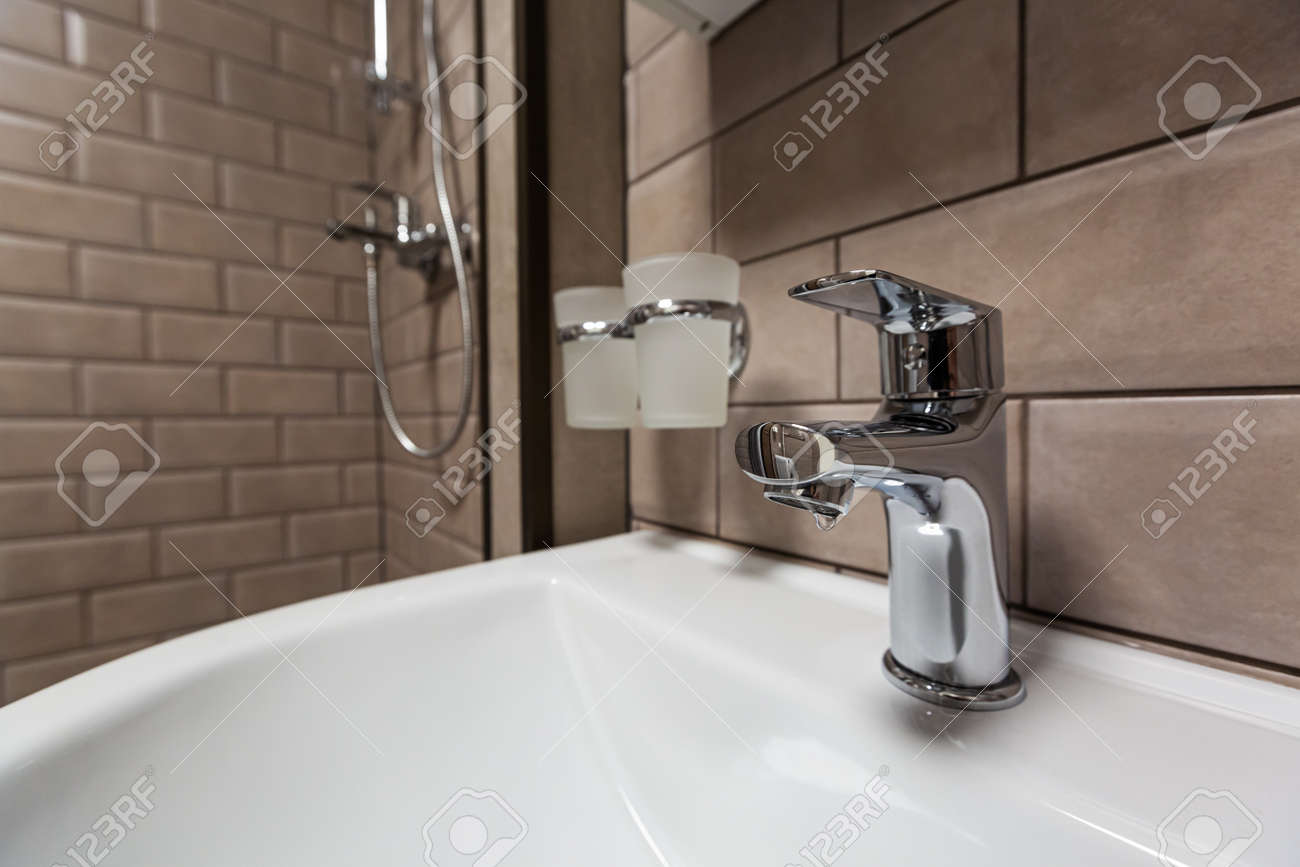Water tap, faucet in the bathroom with sink. Hygiene concept. - 168608369