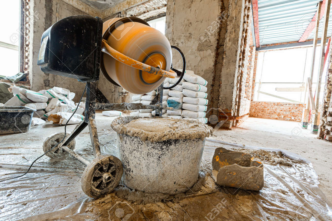 The using the electric concrete mixer in an apartment is under construction, remodeling, renovation, extension, restoration and reconstruction - 170616689