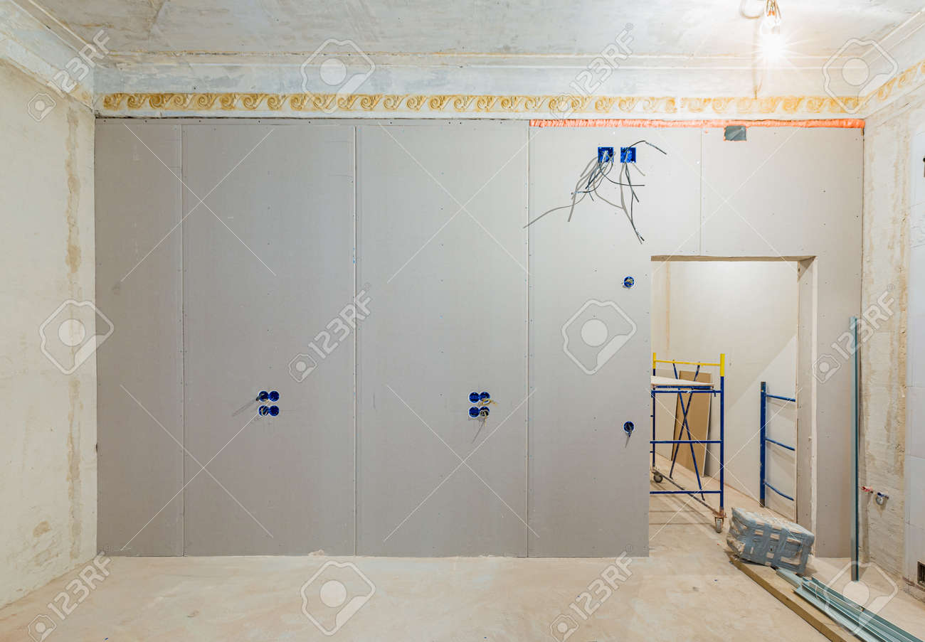 Working process of installing gypsum walls from plasterboard -drywall - in apartment is under construction, remodeling, renovation, extension, restoration and reconstruction. - 170116255