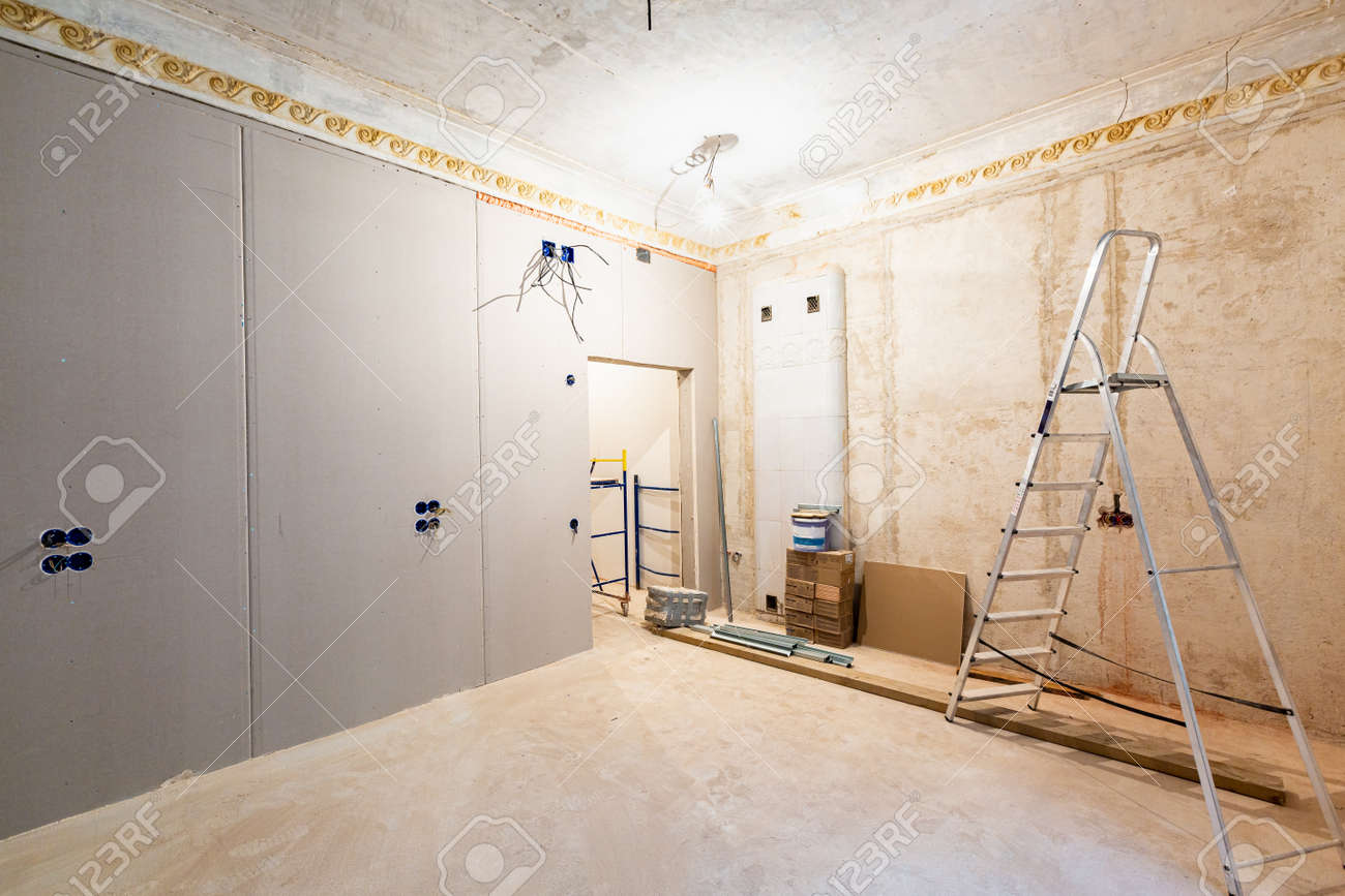 Working process of installing gypsum walls from plasterboard -drywall - in apartment is under construction, remodeling, renovation, extension, restoration and reconstruction. - 170200787
