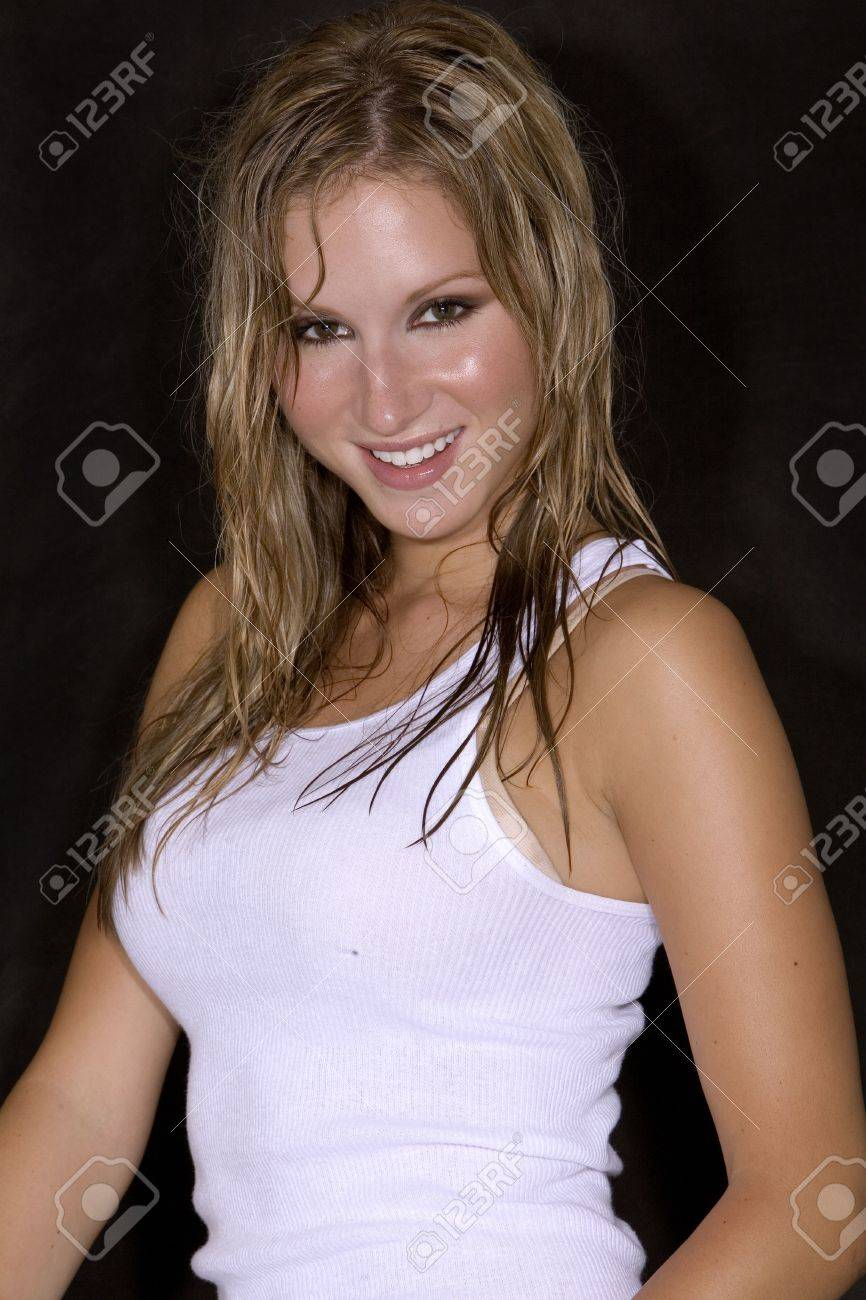 9b401465175 sexy blond girl in white tank top and blue jean skirt Stock Photo - 565960