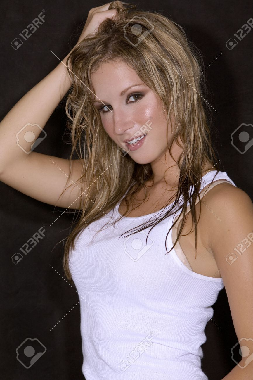 71c3826676b sexy blond girl in white tank top and blue jean skirt Stock Photo - 565950