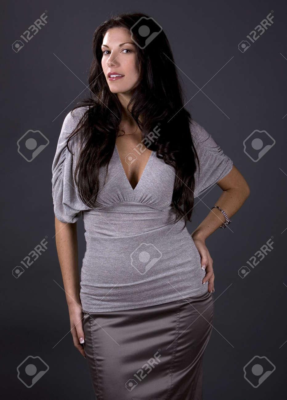 stunning woman wearing grey fashion top and skirt Stock Photo - 2127913