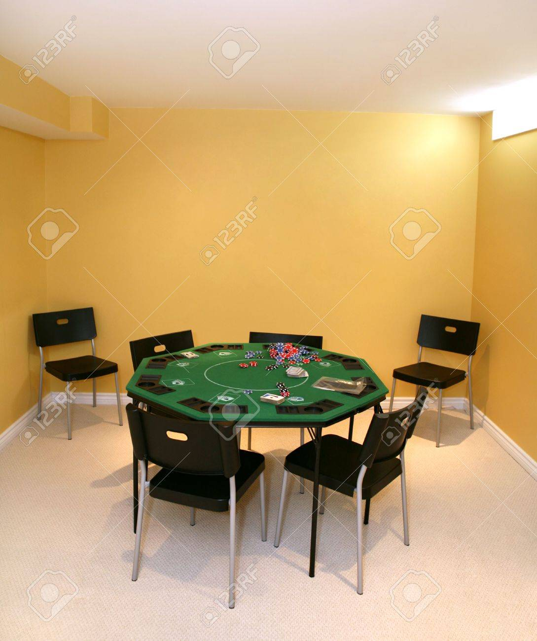 Poker Table With Cards And Chips In The Basement Stock Photo