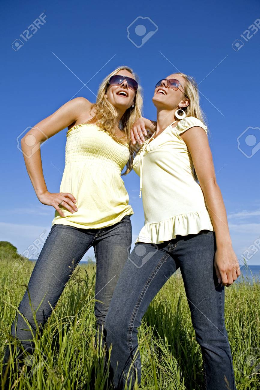 sisters wearing yellow top and jeans in the summer Stock Photo - 3187722