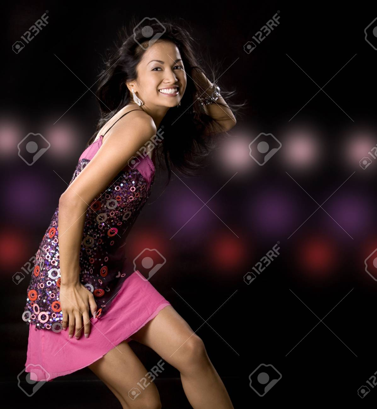 pretty brunette woman having fun on black background Stock Photo - 5581609