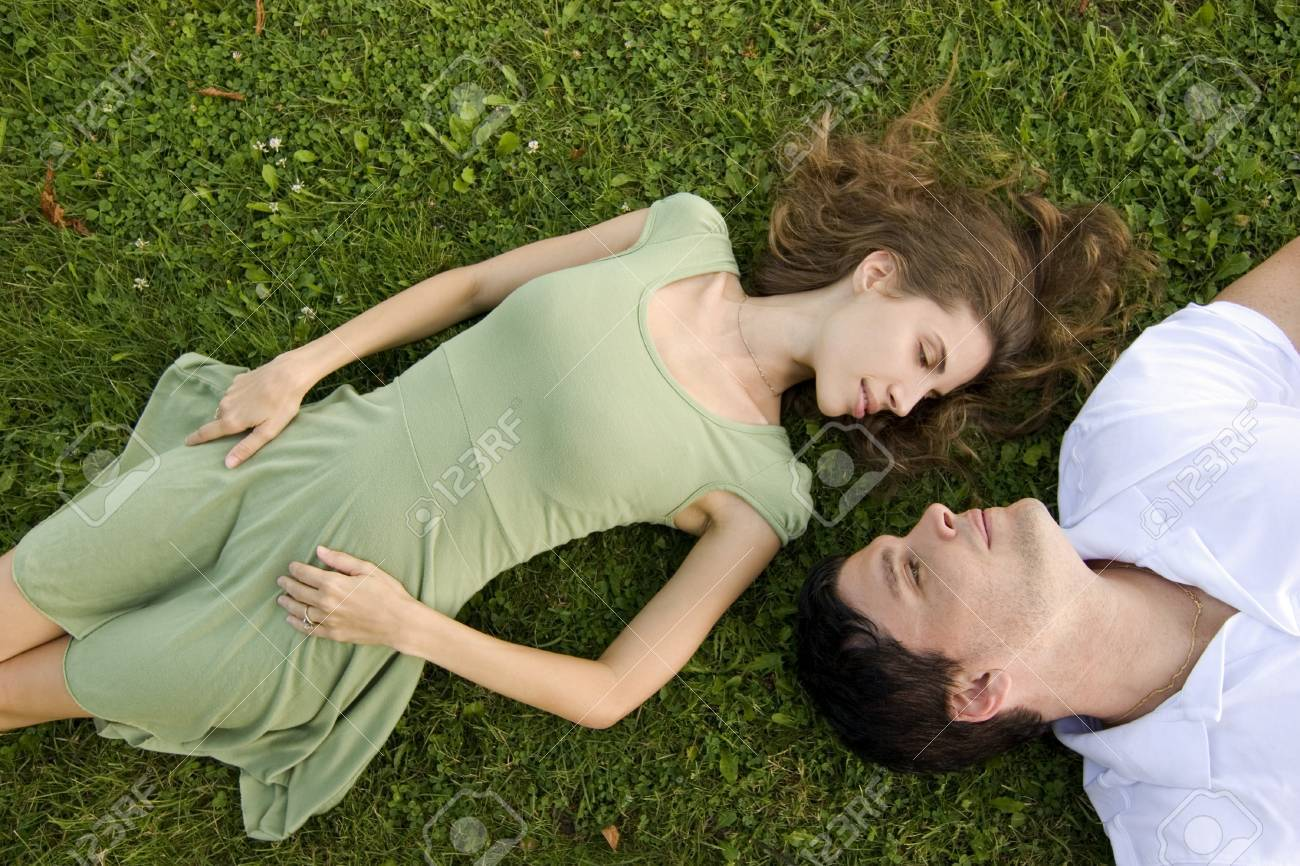 couple in the park relaxing on their backs Stock Photo - 10421912