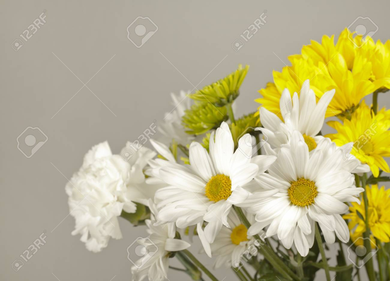 Bouquet Of White And Yellow Flowers On Light Grey Background Stock