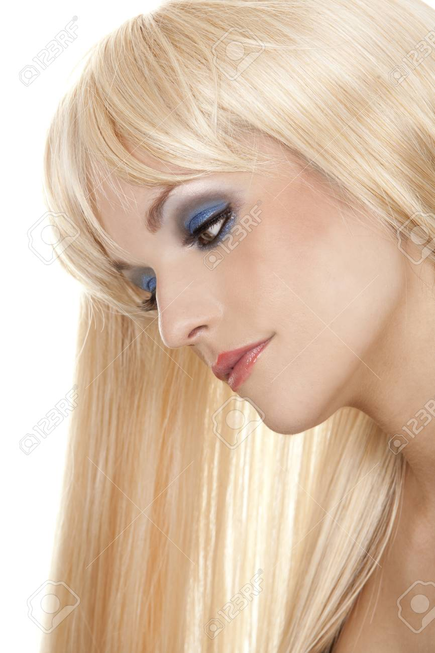 pretty blond woman with colorful makeup on white background Stock Photo - 13308359