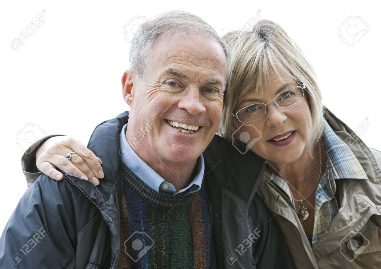 older casual couple sitting in the grass outdoors Stock Photo - 15562789