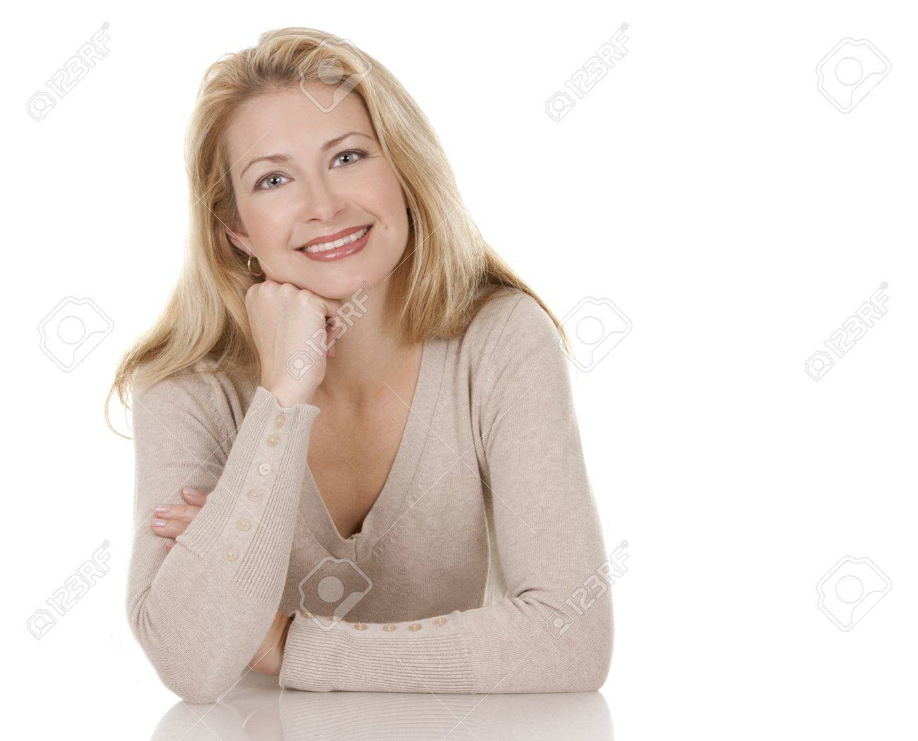 pretty blond woman wearing beige top sitting on white background Stock Photo - 15814954