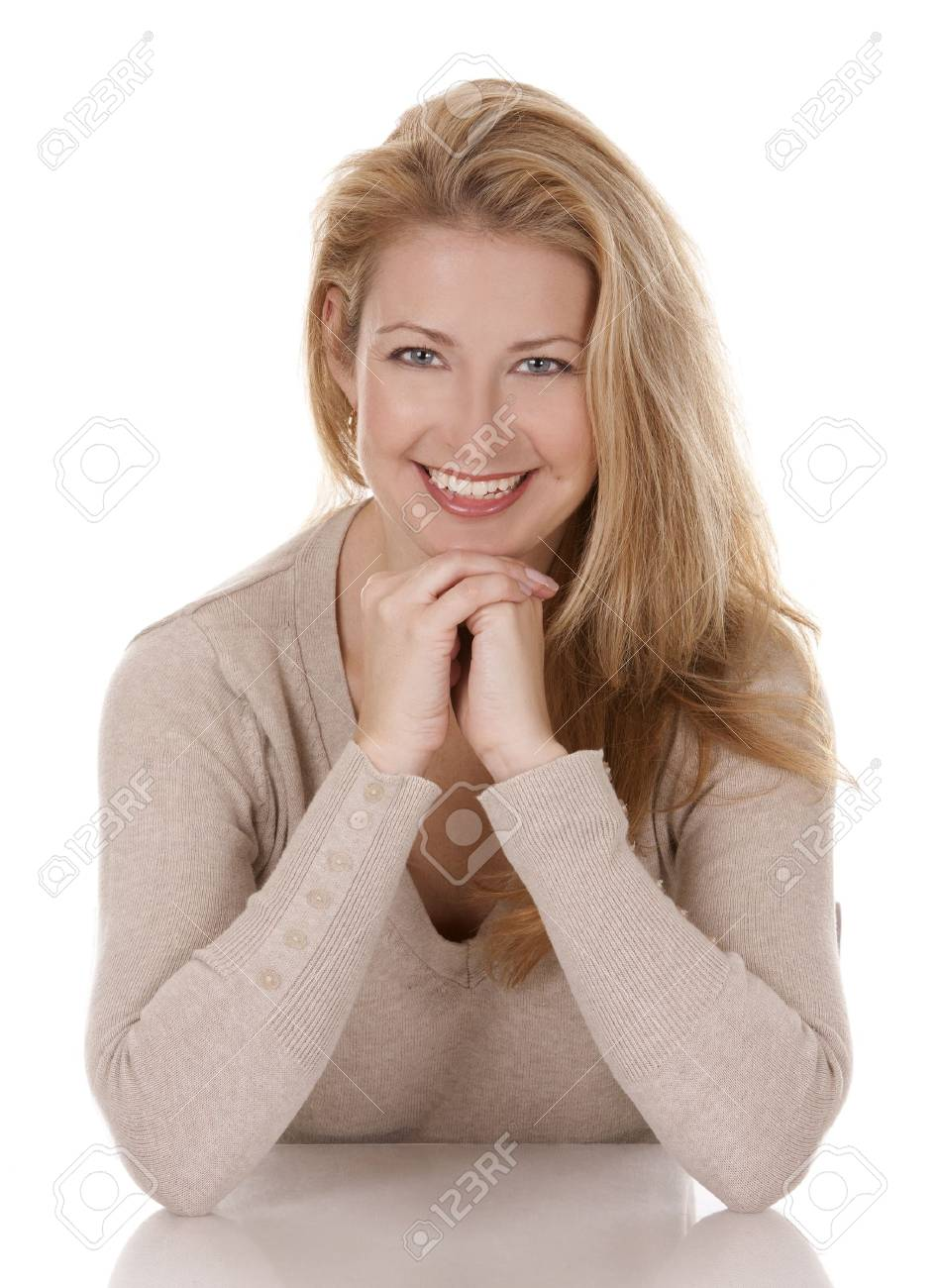 pretty blond woman wearing beige top sitting on white background Stock Photo - 15921171