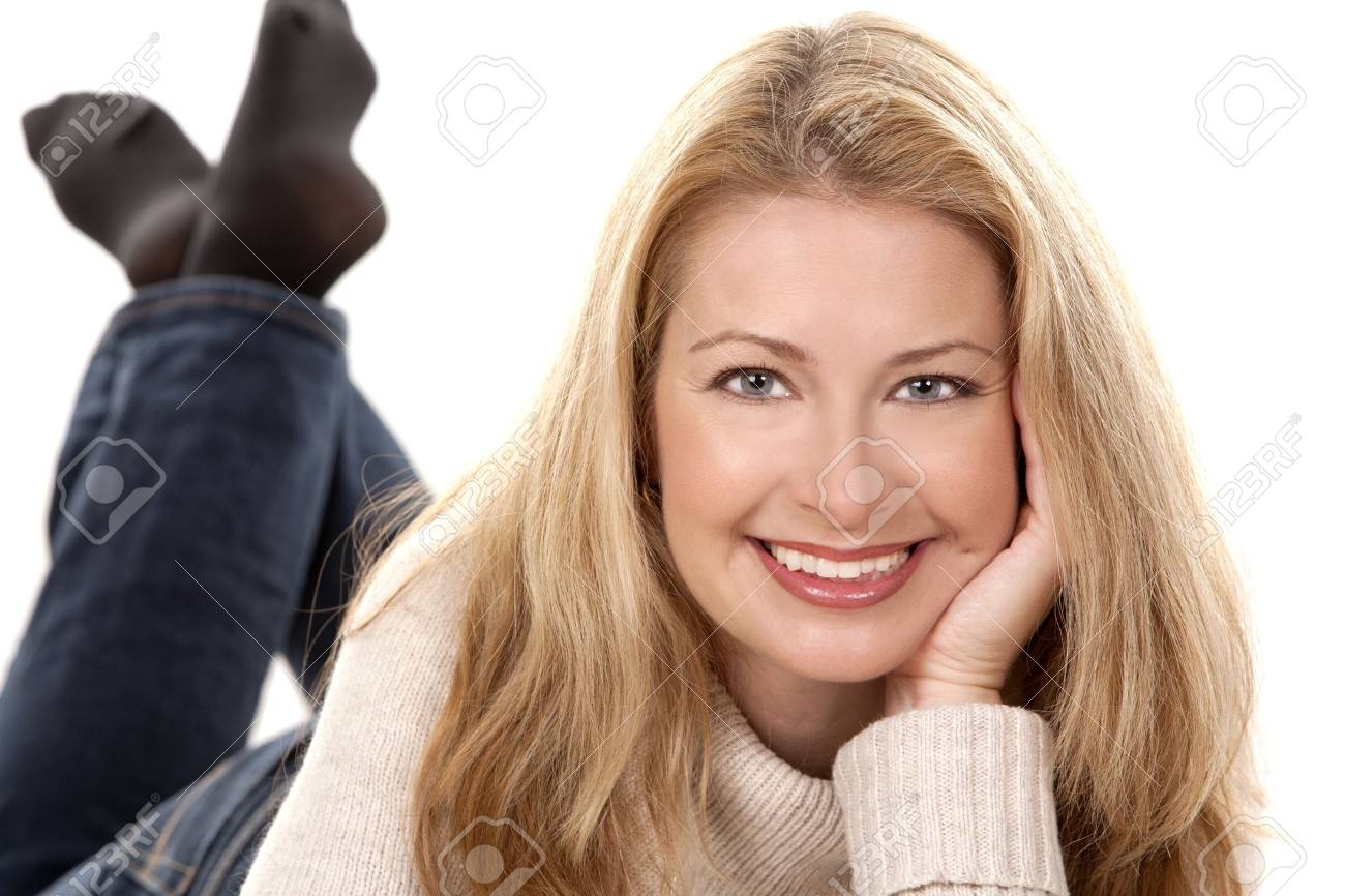 pretty blond woman wearing beige sweather on white background Stock Photo - 16374391