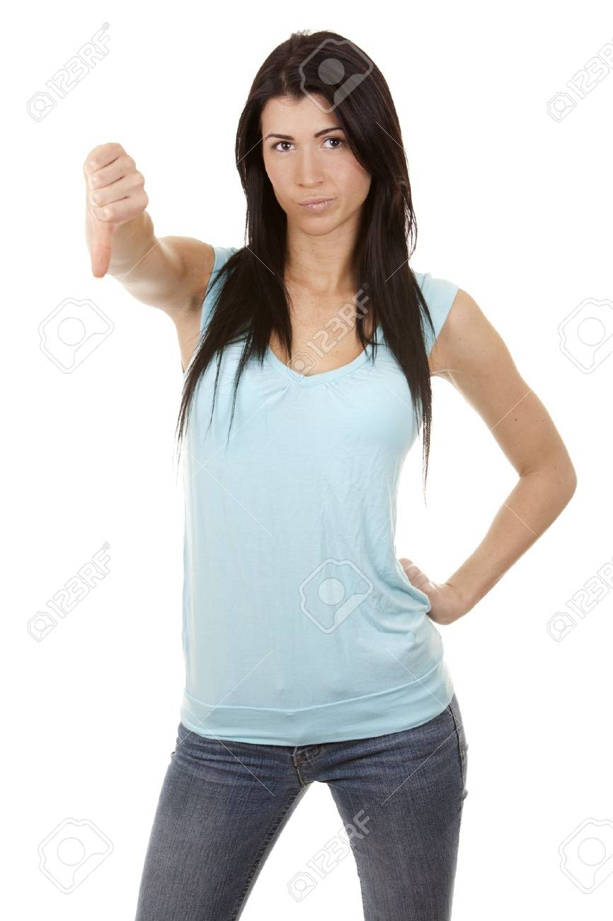 casual brunette showing thumb down gesture on white background Stock Photo - 16560064