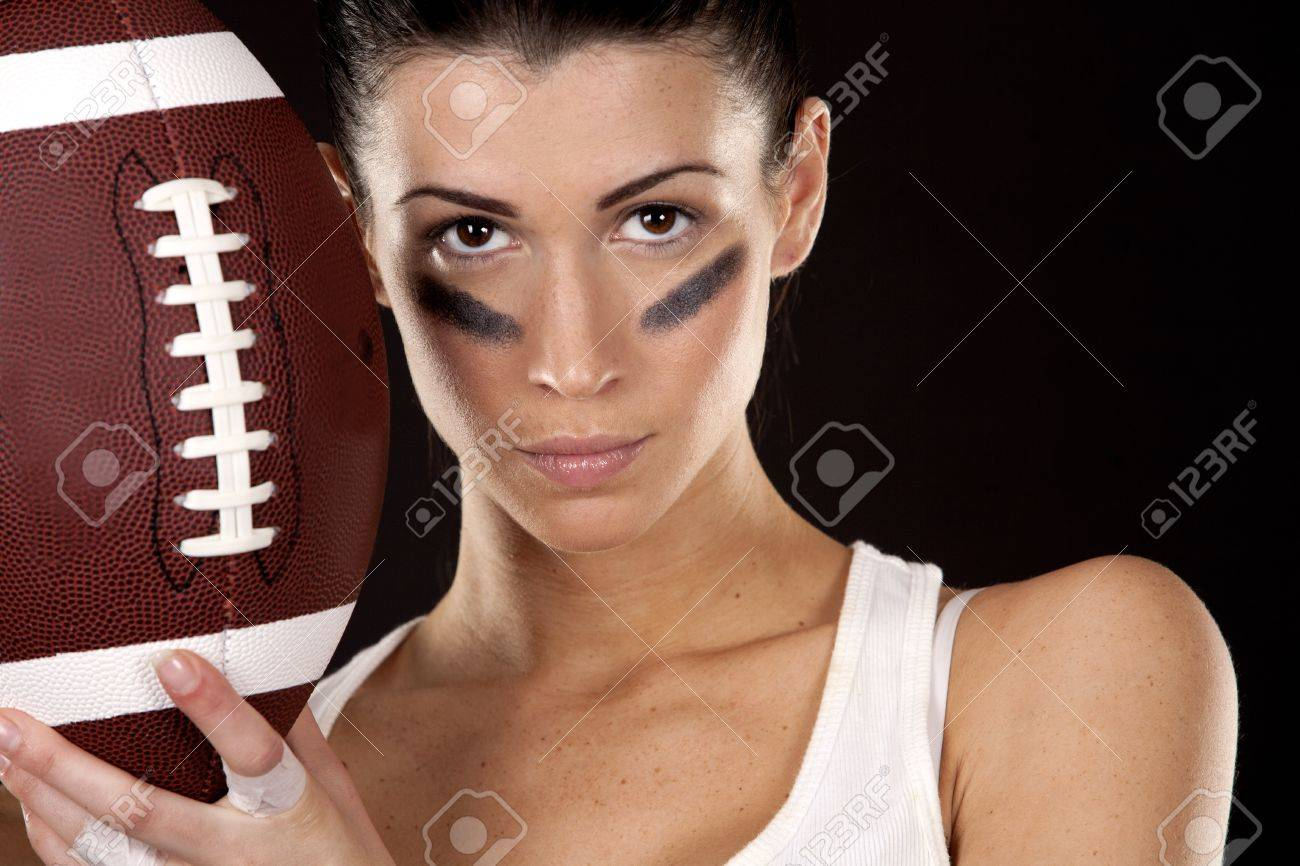 athletic brunette posing as american football girl on black background Stock Photo - 16656799