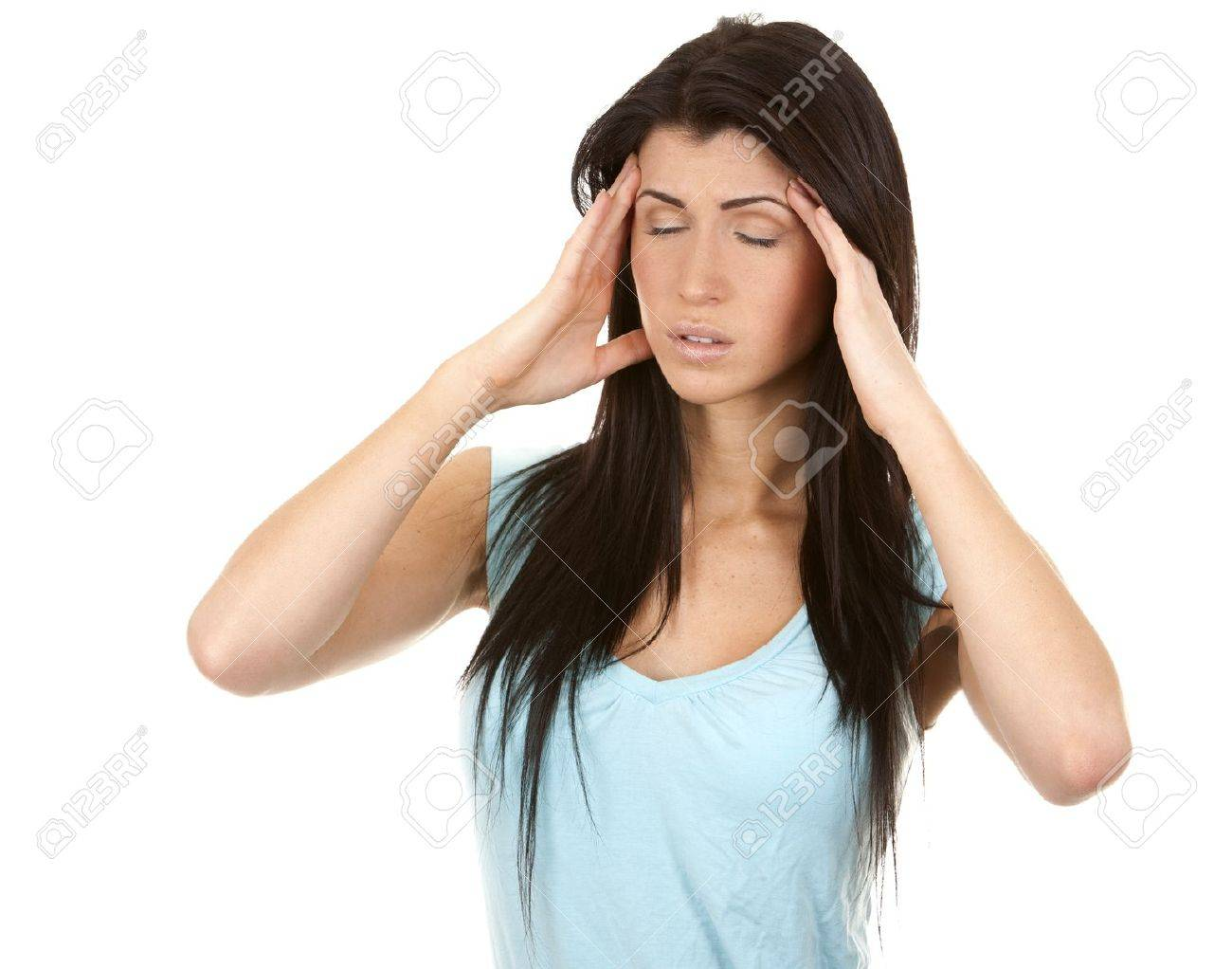 brunette having a headache on white isolated background - 16684429