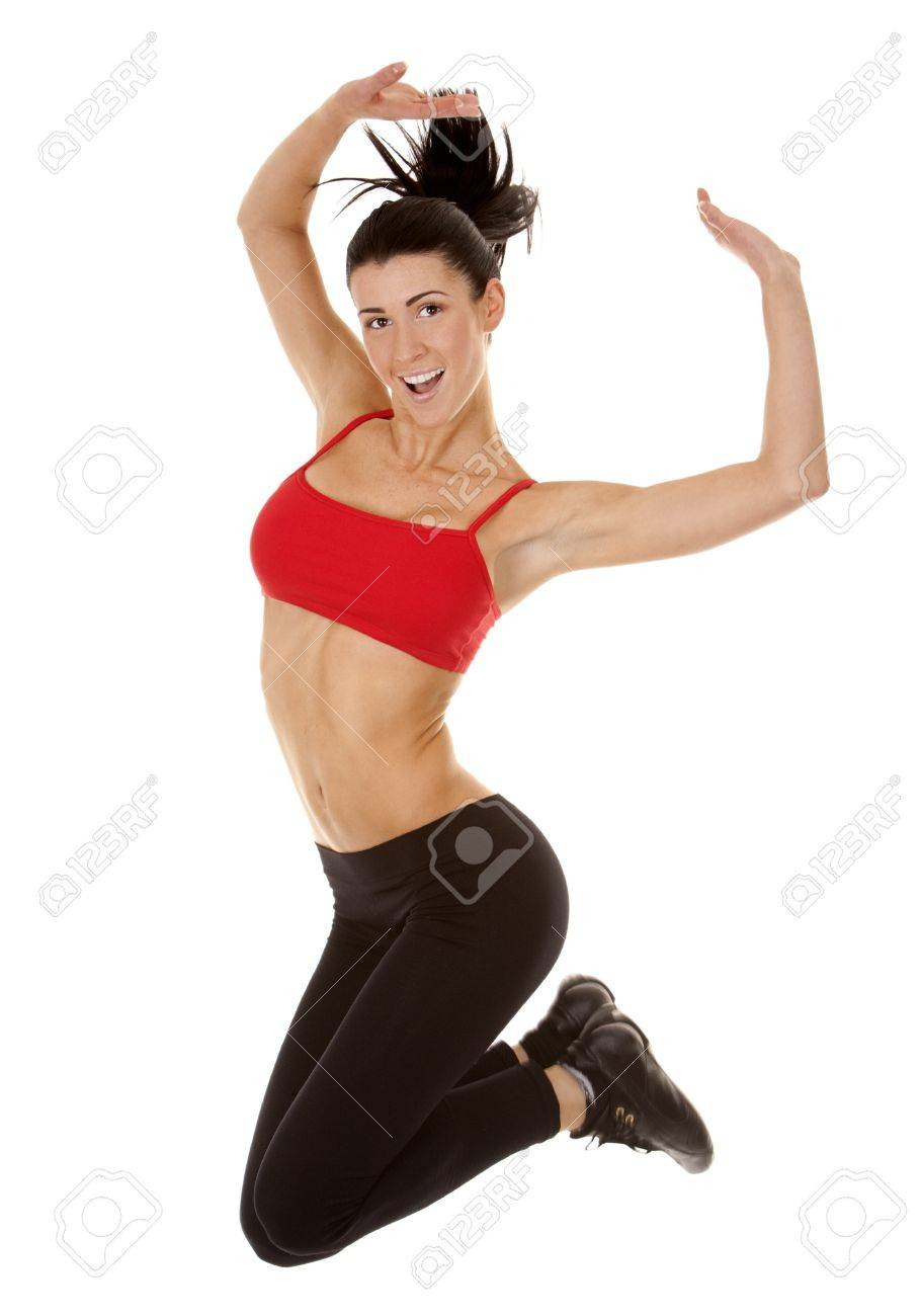 active brunette in red jumping on white isolated background Stock Photo - 16878810