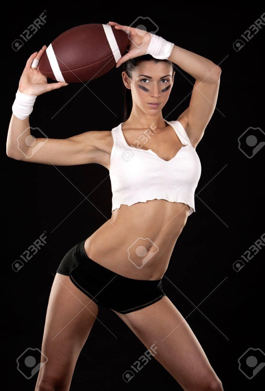 athletic brunette posing as american football girl on black background Stock Photo - 16878871