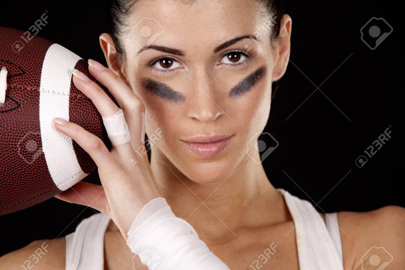 athletic brunette posing as american football girl on black background Stock Photo - 16878877