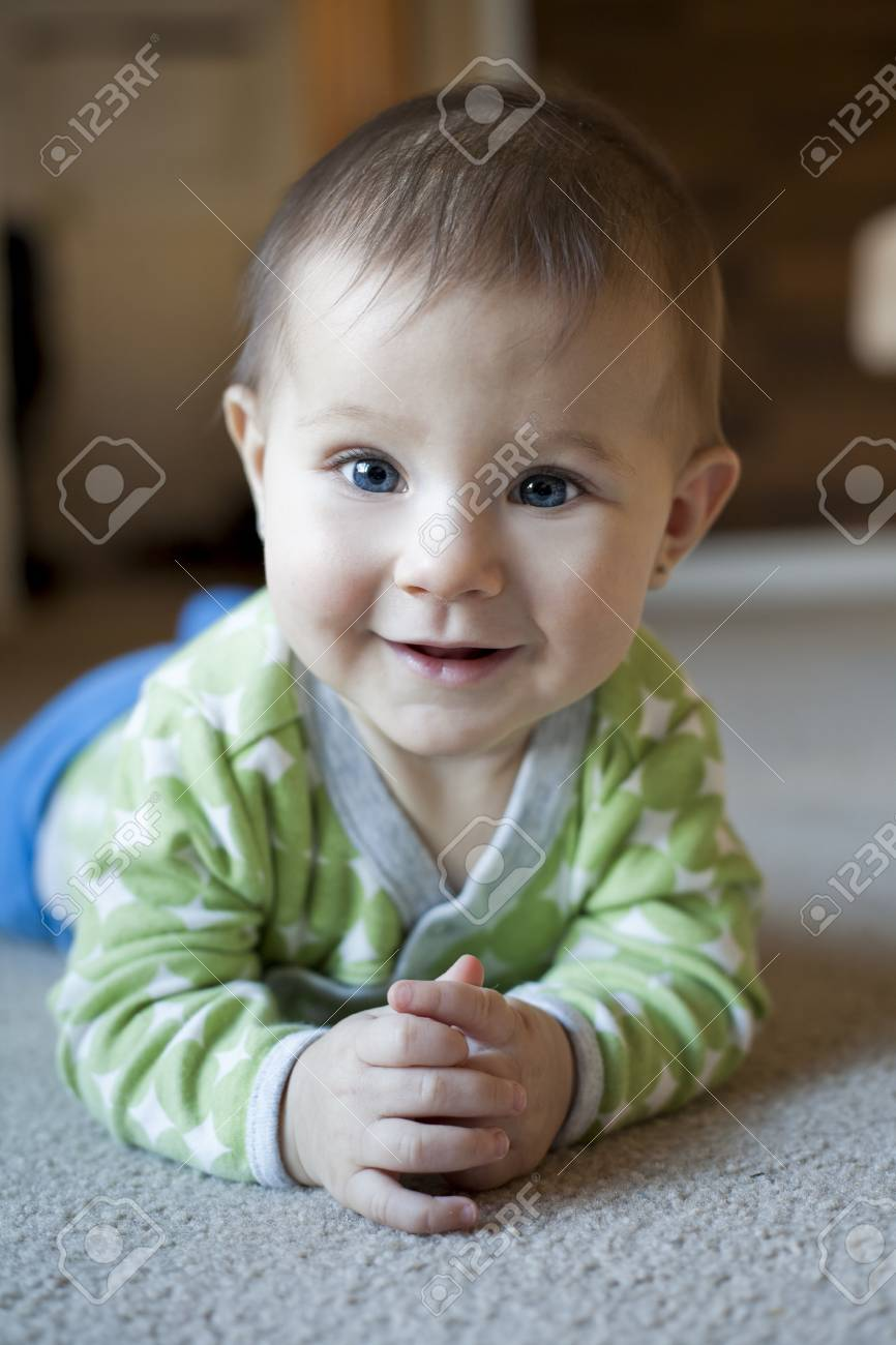 baby girl is playing on the carpet Stock Photo - 16878874