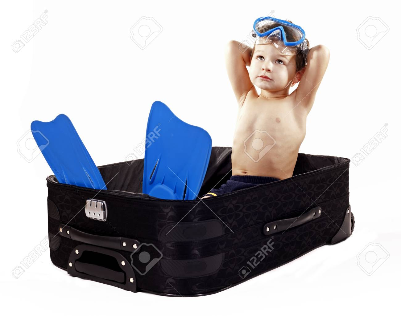 little boy sitting in the luggage wearing snorkel gear Stock Photo - 16878811