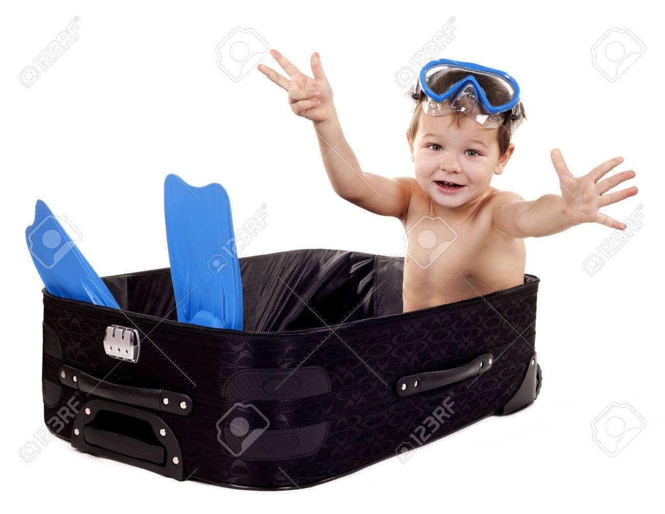 little boy sitting in the luggage wearing snorkel gear Stock Photo - 16878815