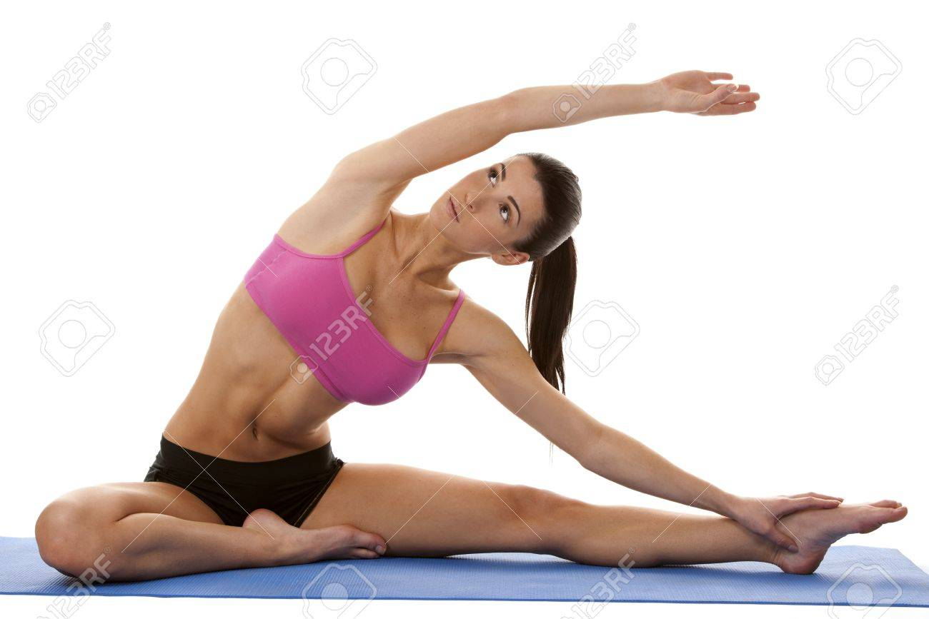 brunette sitting down and stretching her legs on white background Stock Photo - 17500818