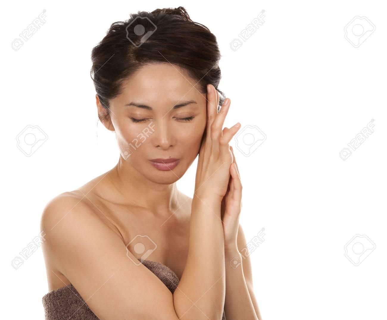 beautiful asian brunette nude on white isolated background Stock Photo - 17573555