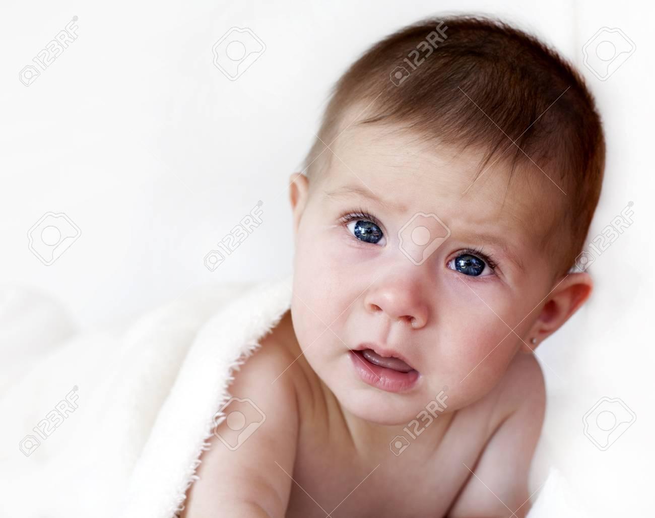 baby girl is sad under white blanket Stock Photo - 17573552