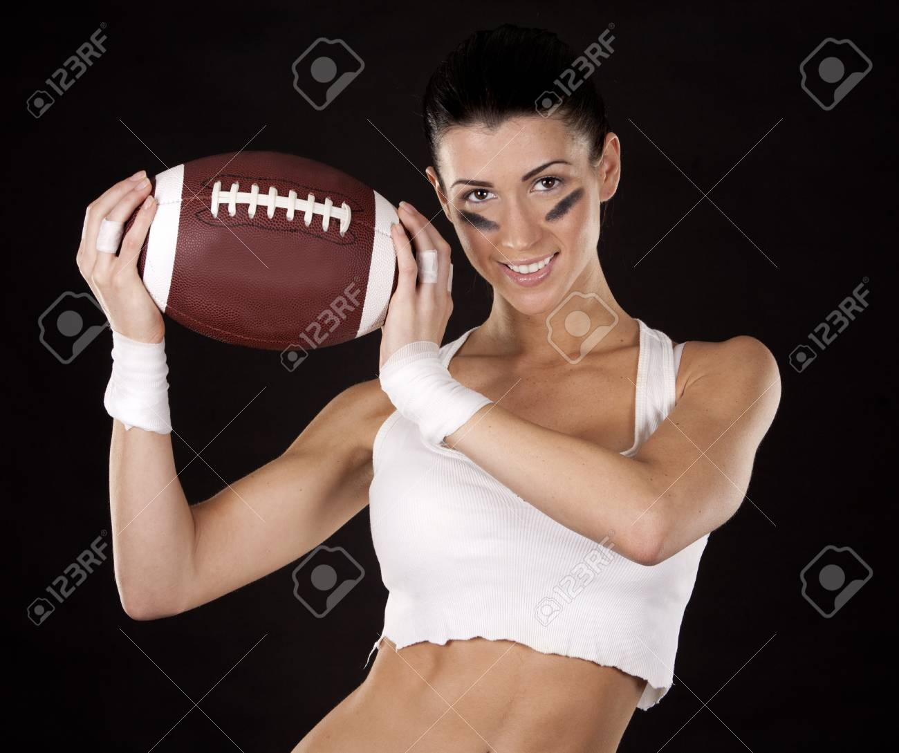 athletic brunette posing as american football girl on black background Stock Photo - 17573583