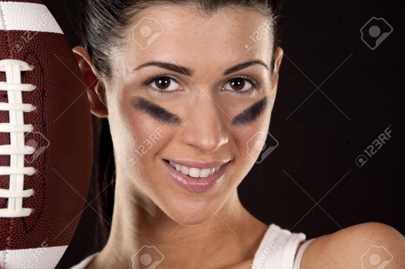 athletic brunette posing as american football girl on black background Stock Photo - 17573603