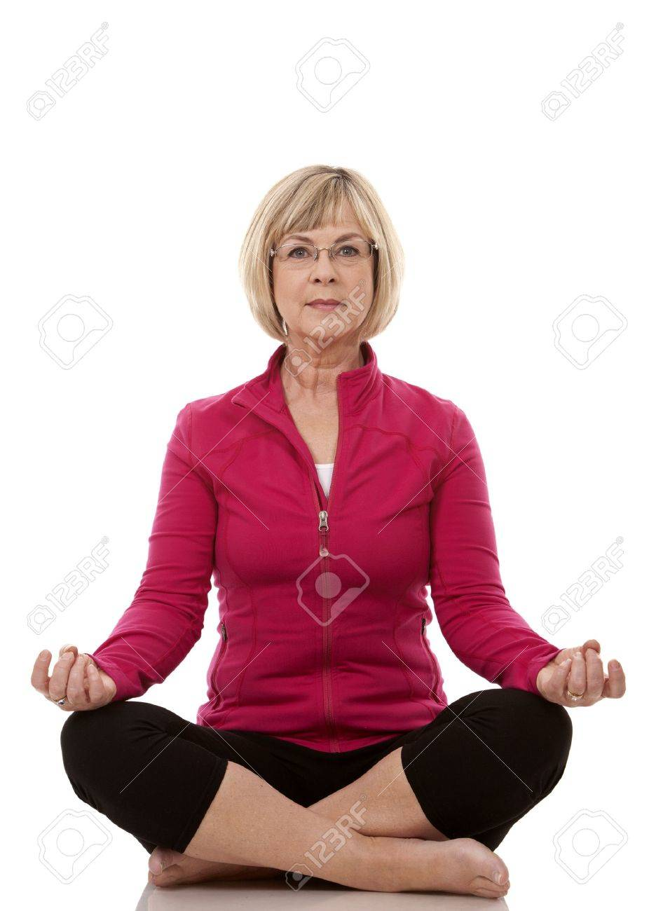 mature woman wearing fitness outfit on white isolated background - 17892793