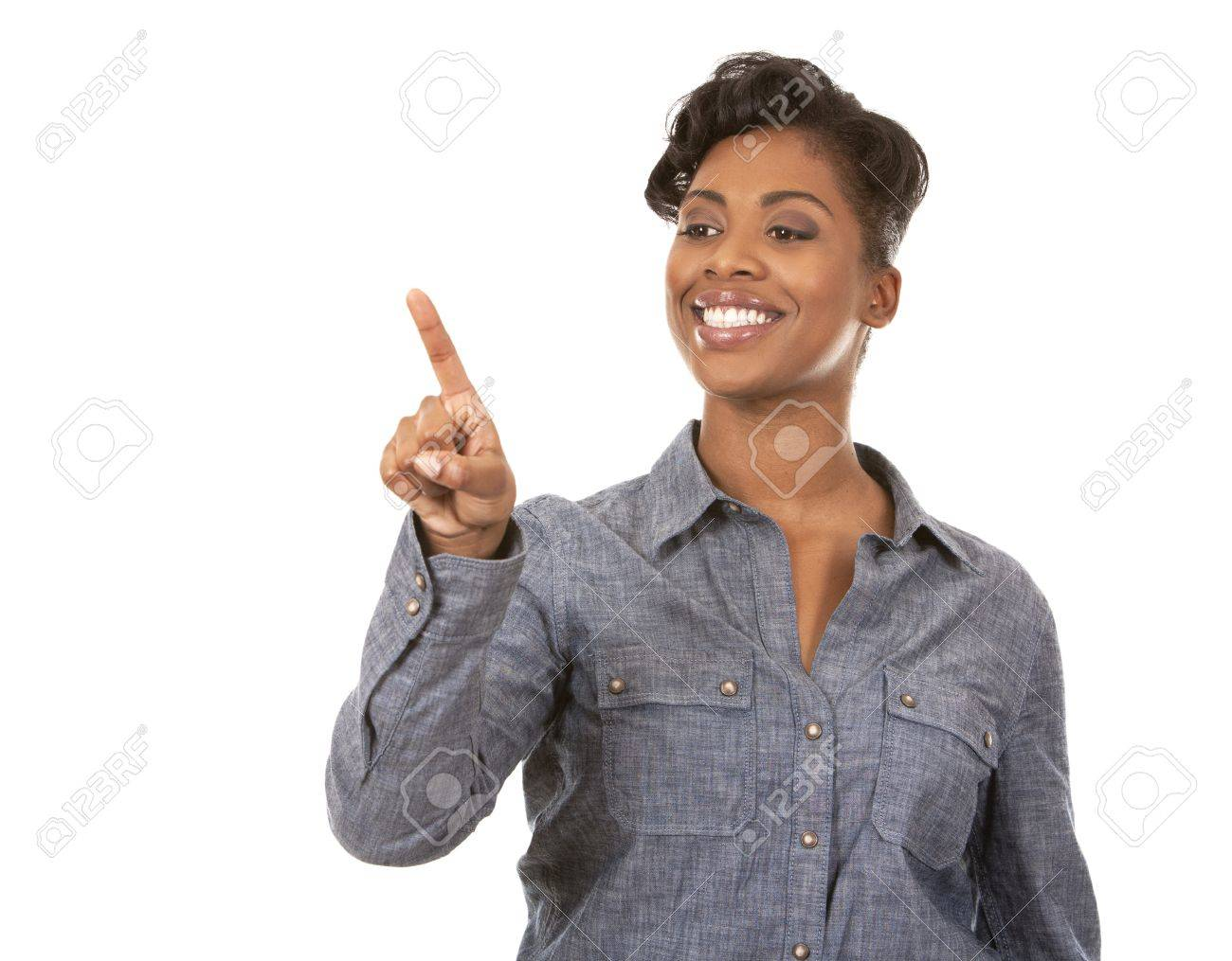 pretty casual black woman pointing with her arm on white background Stock Photo - 18468158