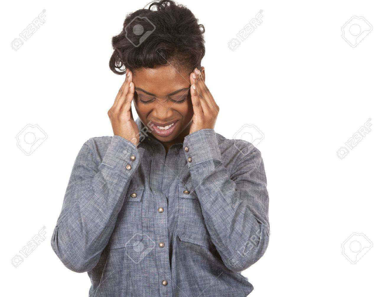 casual black woman with headache on white background Standard-Bild - 18468165