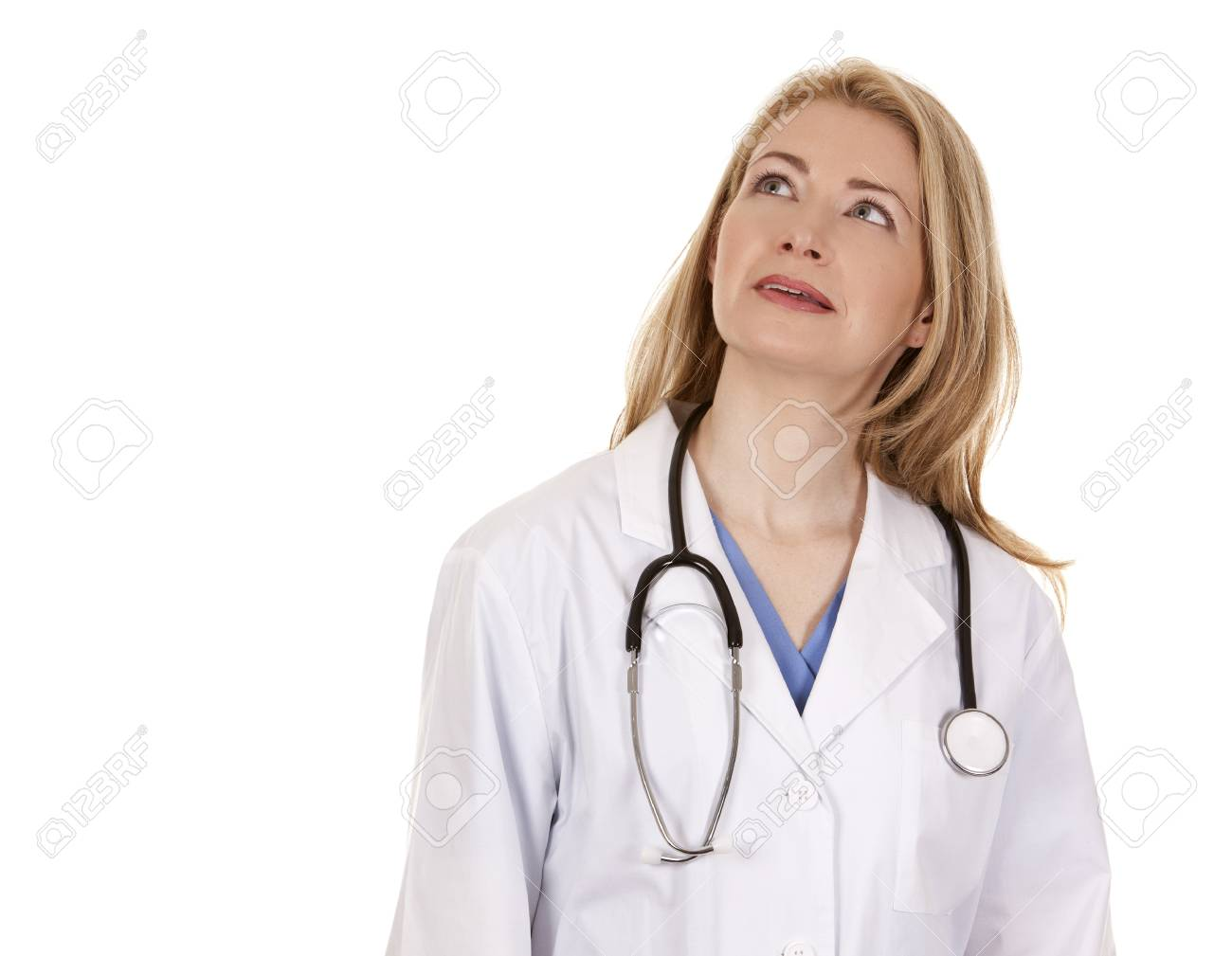 blond female doctor posing on light grey background Stock Photo - 18843540
