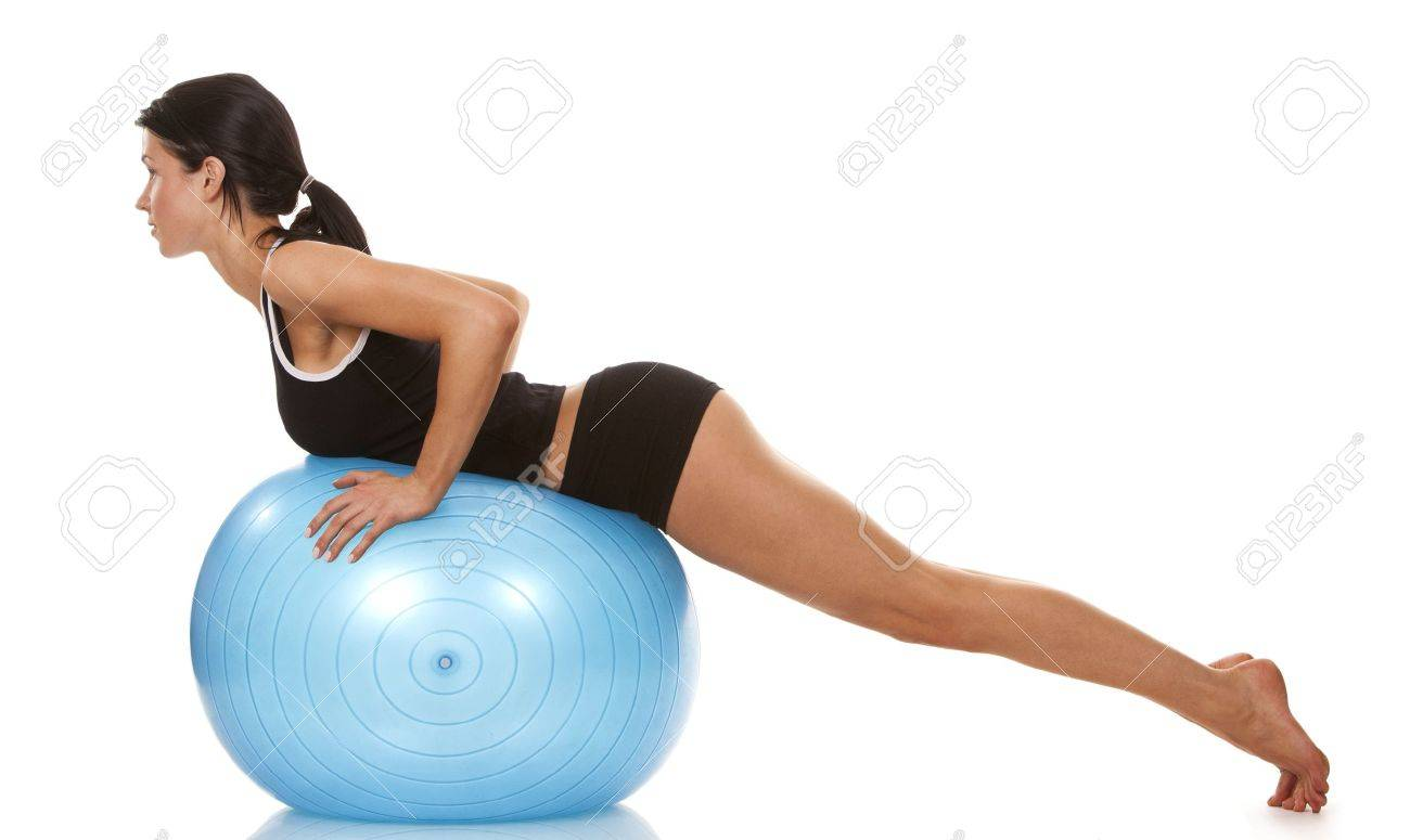 female fitness model exercising with blue ball Standard-Bild - 19063562