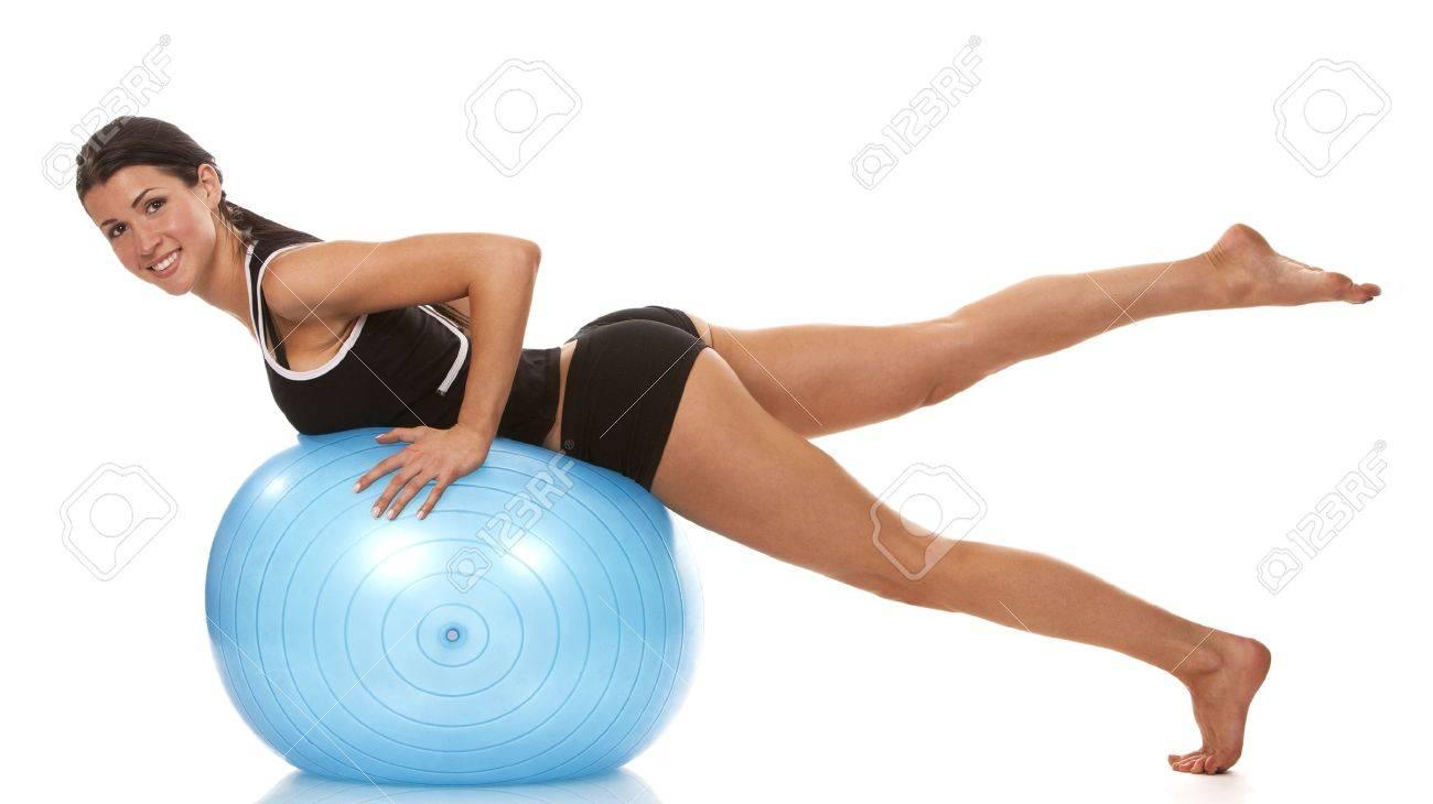 female fitness model exercising with blue ball Standard-Bild - 19063568