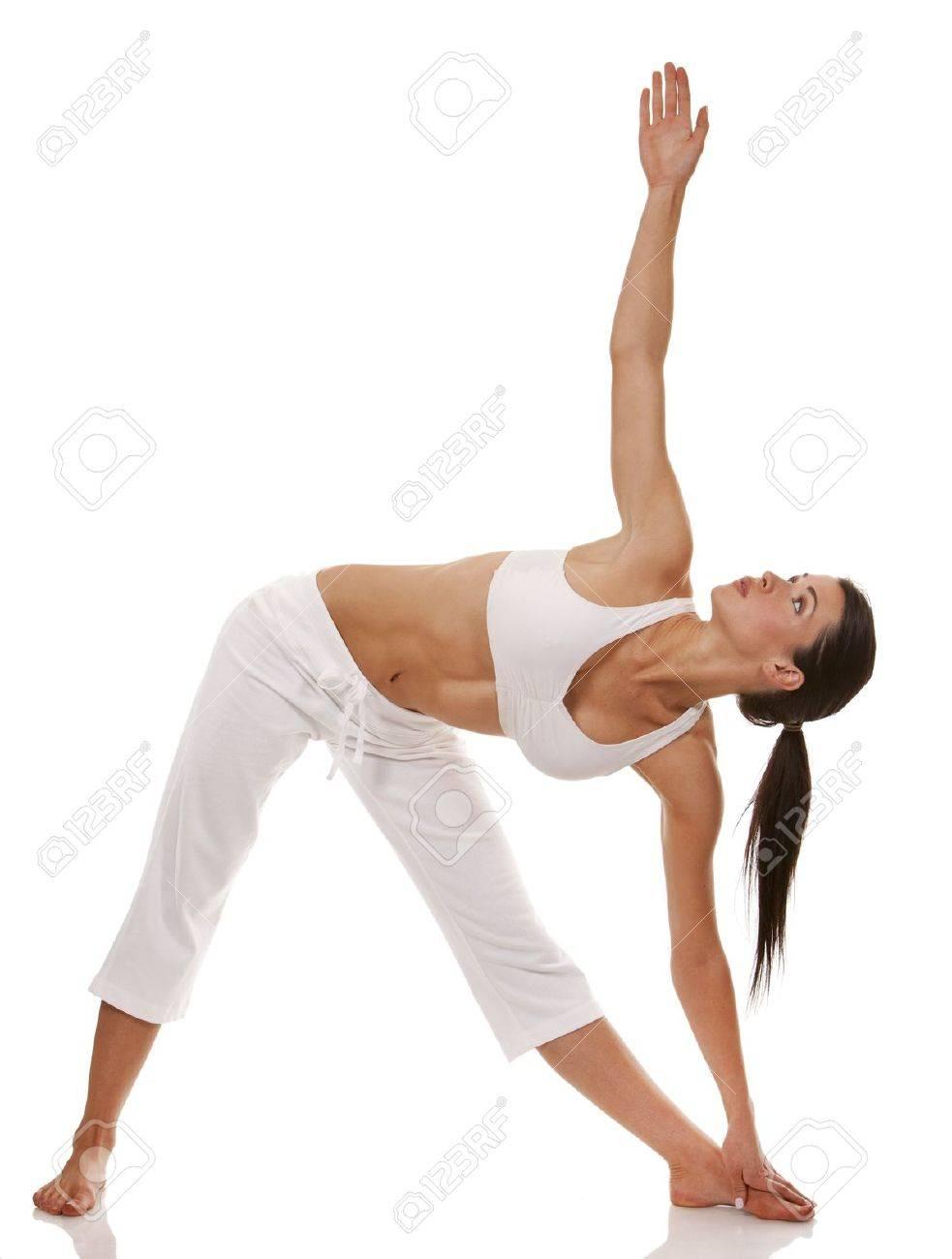 pretty brunette is exercising yoga on white background Standard-Bild - 19147621