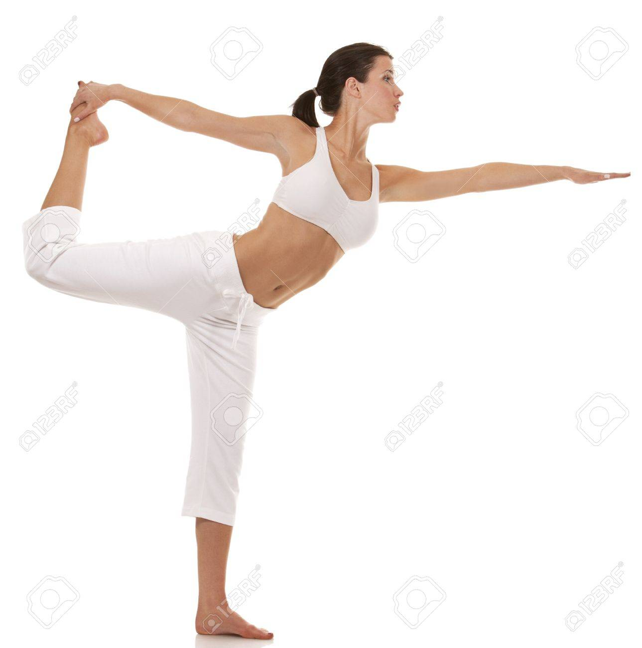 pretty brunette is exercising yoga on white background Standard-Bild - 19168314