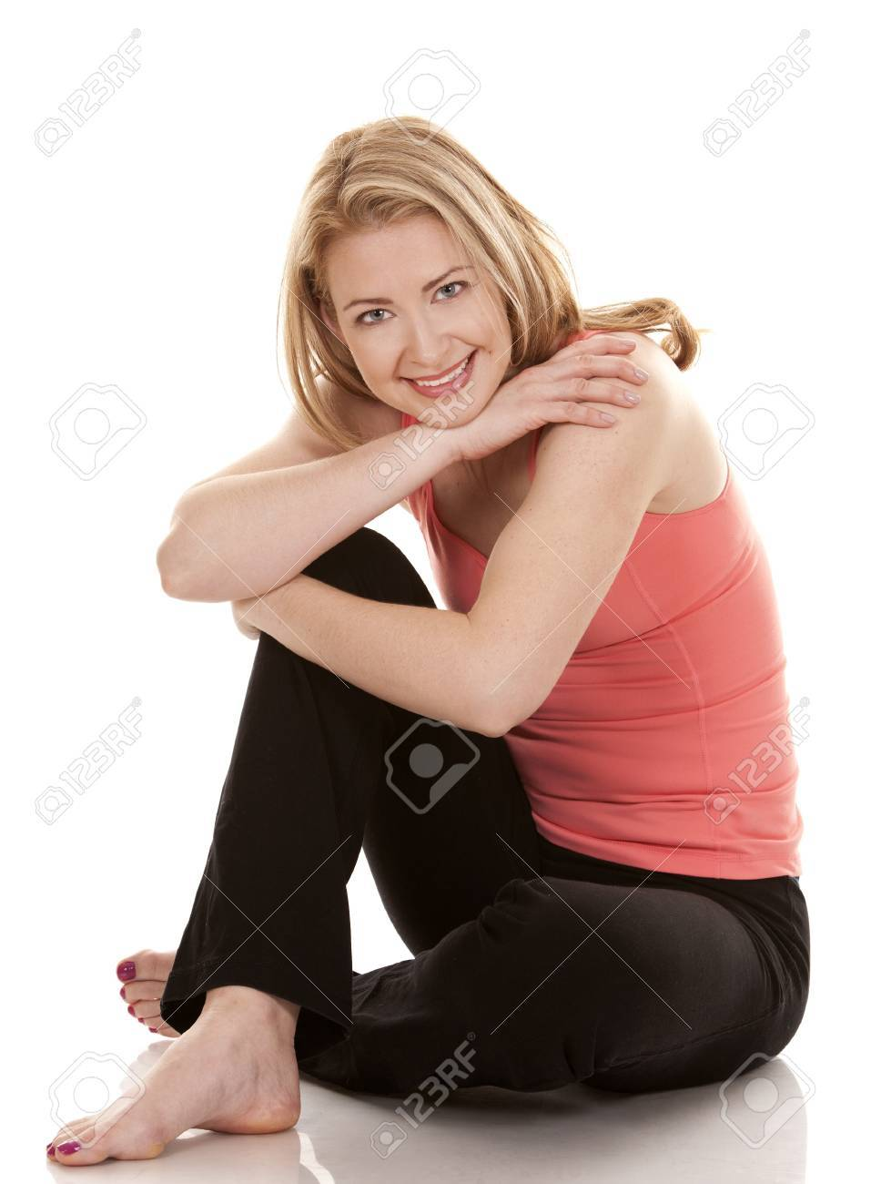 pretty blonde wearing active wear on white background Stock Photo - 19356860