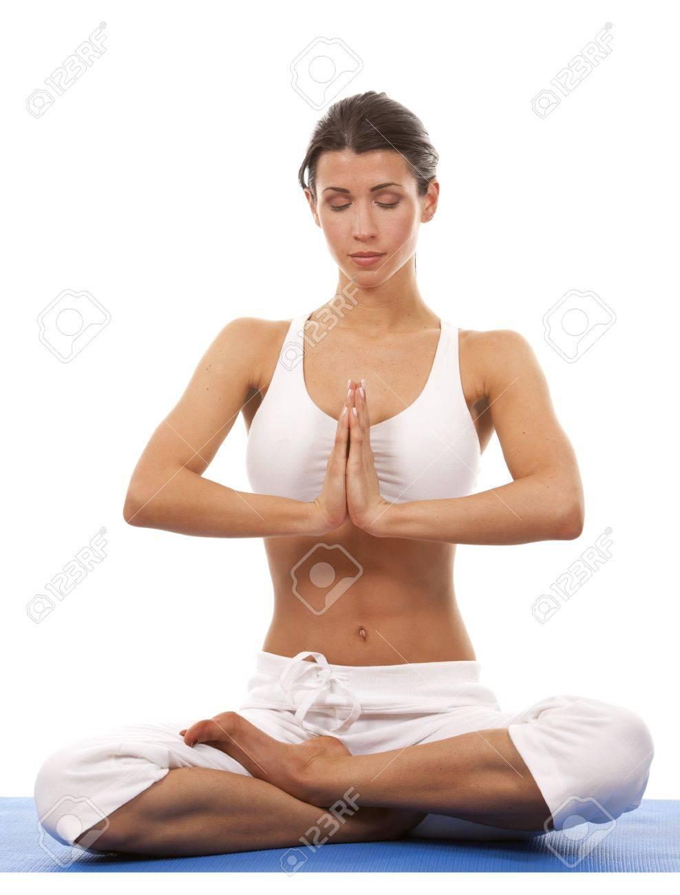 pretty brunette is exercising yoga on white background Stock Photo - 19356855