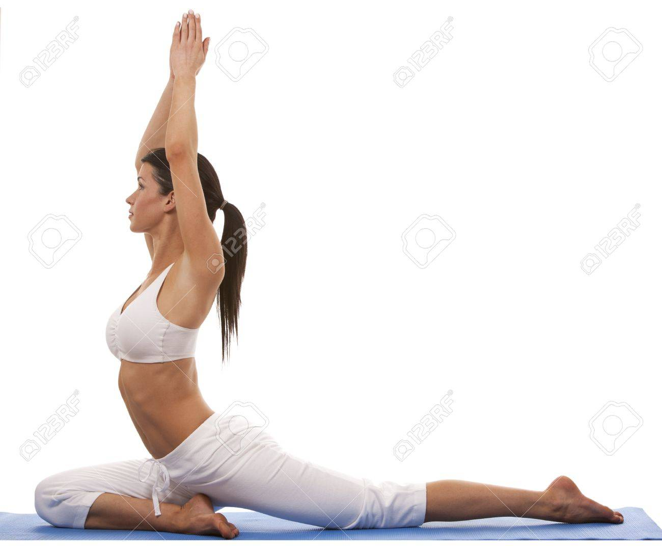 pretty brunette is exercising yoga on white background Standard-Bild - 19356886