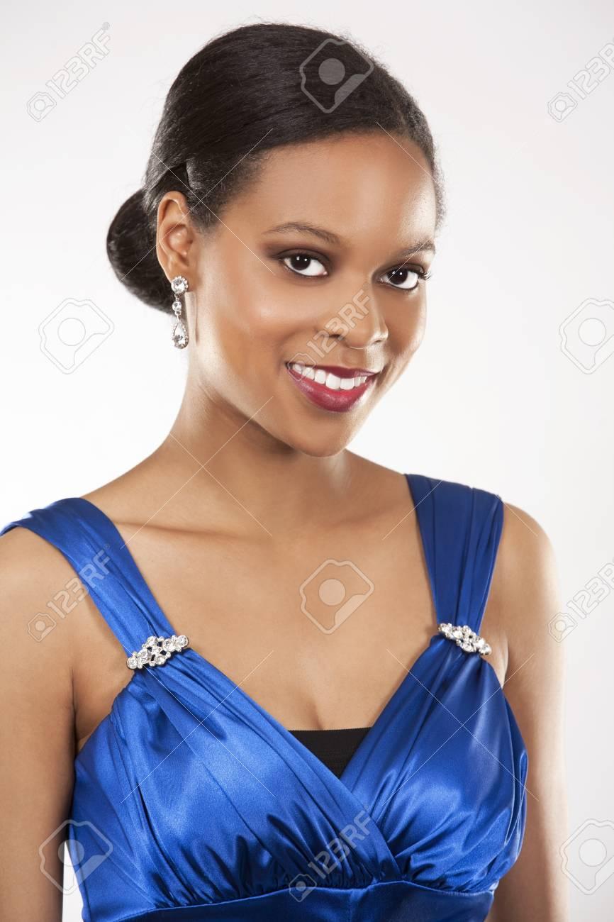 beautiful woman wearing blue evening dress on light background Stock Photo - 20787384