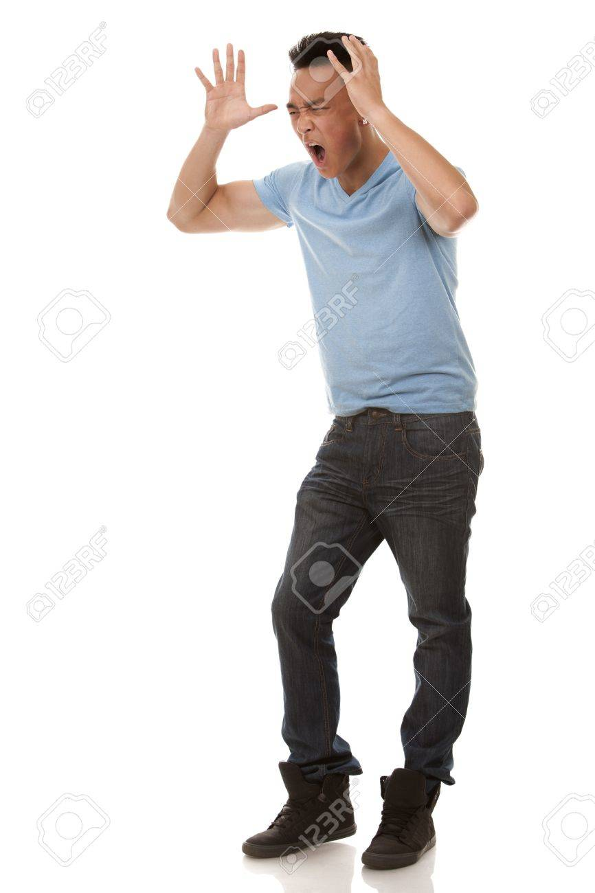 casual man wearing blue tshirt and jeans on white background Standard-Bild - 20989562